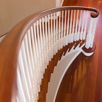Custom curved steps and wooden handrails